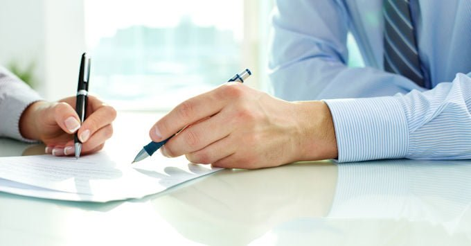 Independent insurance agent reviewing coverage with new client